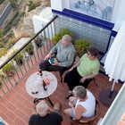 Travelers on Apartment Patio, Arcos de la Frontera, Andalusia, Spain