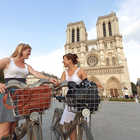 Gals on bikes outside Notre Dame Cathedral, Paris, France