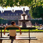 Park bench, Place des Voges, Marais, Paris, France