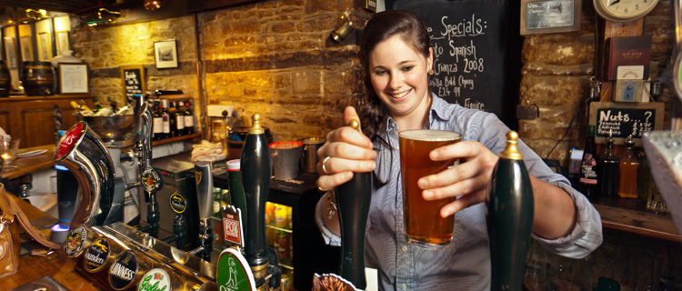 Pouring a pint in a pub in England's Cotswolds